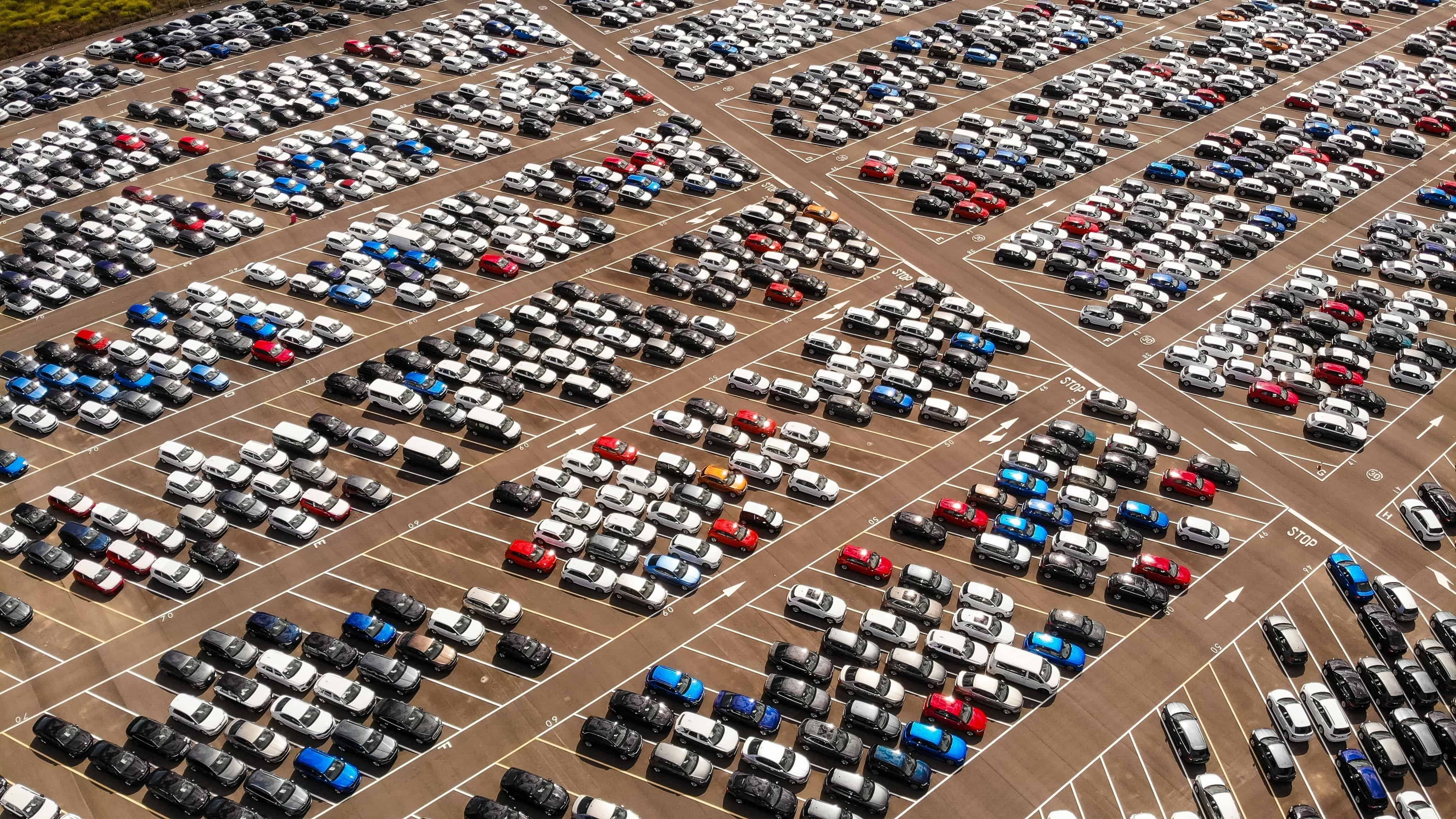 Parking lot with different colored cars