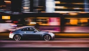 Sideview of a car, with background blurred to show how fast the car it. Photo by toine G on Unsplash